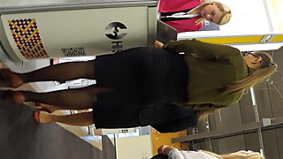Candid expo girls in a office look black pantyhose and heels